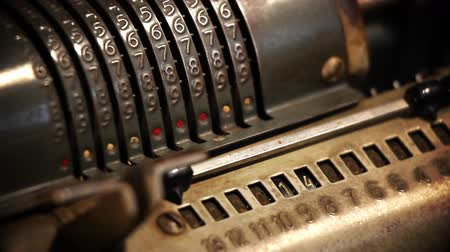 užitečnost : Close up of changing numbers on an old cashier with changing focus and shaky camera for dramatic impression