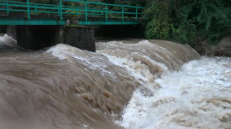 floods : View of the increased restless river runing under the iron bridge