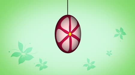 religião : Animated Easter egg spinning with the flower background Vídeos