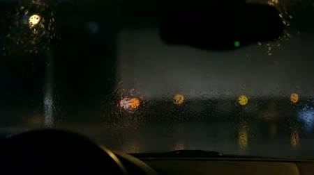 drive : Shot through windshield of nightdrive on rainy night