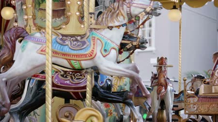 gidip : TRIESTE, ITALY - SEP 15, 2013: Wooden horses and fairytale carriges on running roundabout