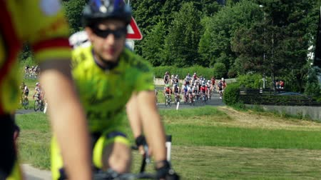 sportsmen : VRHNIKA, SLOVENIA - AUG 24, 2013: Unfocused shot of fast driving and competing cyclists