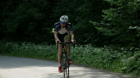 bisiklete binme : VRHNIKA, SLOVENIA - AUG 24, 2013: Male cyclist is showing his skilful racing skills on cycling competition
