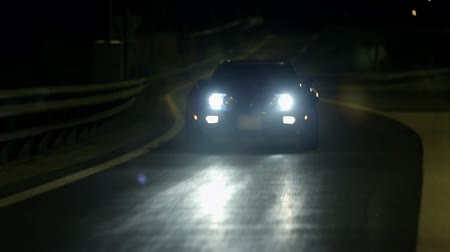 auto show : Corvette driving on concrete road at night