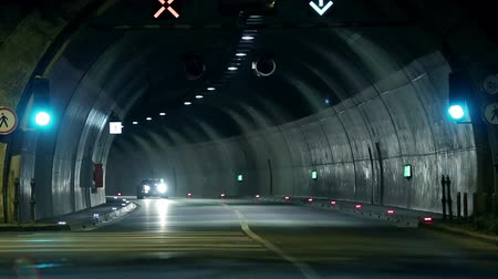 auto show : Corvette driving through the tunnel towards the camera Stock Footage