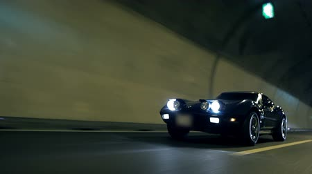 detail : Low angle diagonal shot of Corvette driving through the tunnel