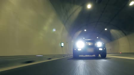 samochód : Blue Corvette crosses the road in a tunnel