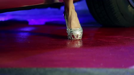 step : Woman in high heels stepping out of Corvette Stock Footage