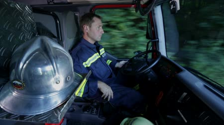 acil durum : Fireman driving a firetruck shot in a cabin Stok Video