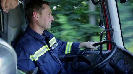 paramedic : Fireman driving through the country in a firetruck Stock Footage