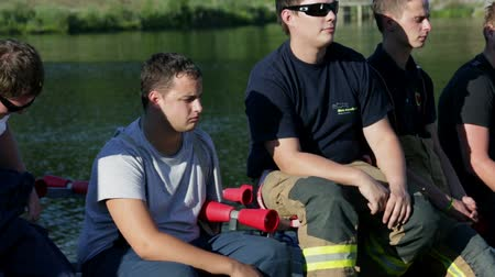 firemen : Group of fireman sitting and talking Stock Footage