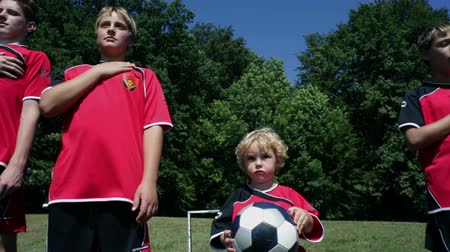 marş : Kids listening to the national anthem in football dress Stok Video
