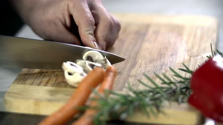 cutting up : Cutting up the button mushrooms