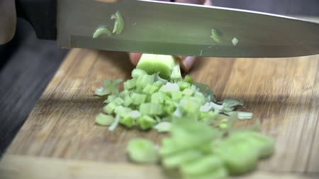 vegetable wok : Cutting up the leek oon wooden desk