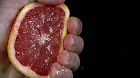 beslenme : Detail shot of man squeezin the grapefruit