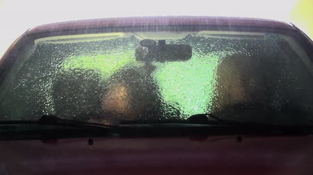 inside car : Car being washed out in carwash shot in slow motion Stock Footage