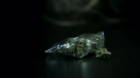 stoned : Pan shot of marihuana sealed in a small plastic bag