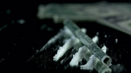 snorting : Throwing the money bill over the cocaine lanes
