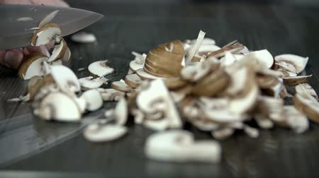 houba : Slicing a bunch of mushrooms into thiny pieces in slow motion