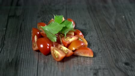 gotowanie : Bunch of sliced tomatoes with some spices in slow motion Wideo