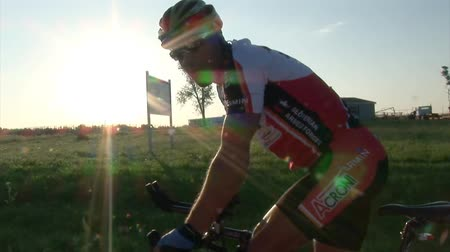 cyclists : USA - JUNE 2009: RAAM competitor at the sunset. Longest bicycle competition over United States of America - RAAM in 2009. Stock Footage