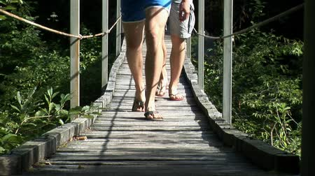 стрельба : Guys cross small bridge in sandals