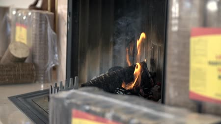 briquette : Fireplace surrounded with briquettes packages Stock Footage