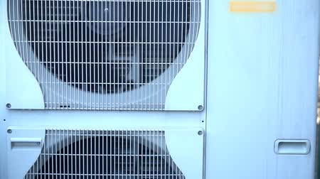 briquette : Tilt shot of big air conditioner
