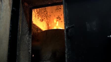 briquette : Fire inside of a big furnace