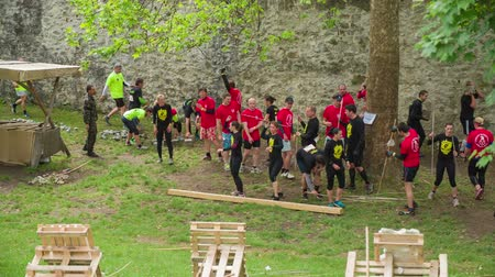 javelin : CELJE, SLOVENIA - MAY 2014: Gladiator games with obstacles while running on track. People throwing spears