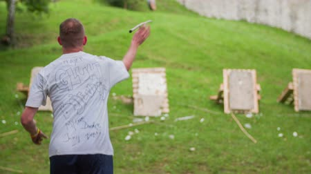 javelin : CELJE, SLOVENIA - MAY 2014: Gladiator games with obstacles while running on track. Man  throwing spear