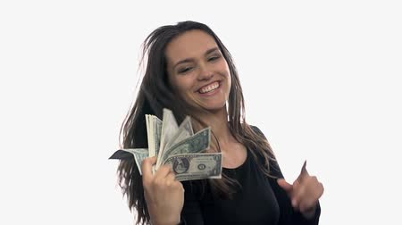 zengin : Ritch woman playing with money. Attractive woman ritch bitch provoking with pack of money on white background slow motion.