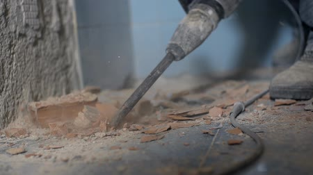 çini : Drilling under blue ceramic tiles. Removing old ceramic tiles with special long and strong drill attached to electric drill