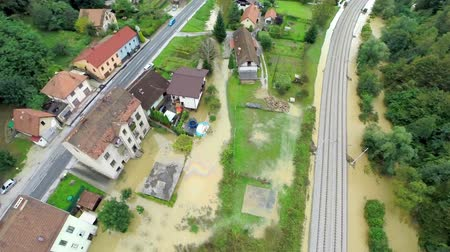 floods : Flying over flooded houses and railway. Aerial footage of home buildings under water because of rising river after massive rain. Stock Footage