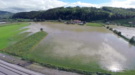 destruído : Flying over railway with flooded field. Slovenia flooding of rivers after heavy rain aerial shot.