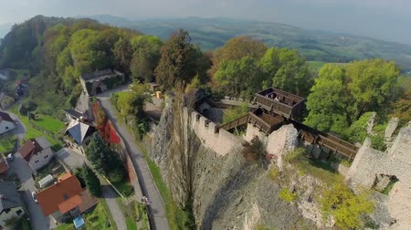 к северу : Medieval castle deep in the countryside. Helicopter camera flying across the midlives  castle in the middle of the beautiful landscape on sunny summer day.