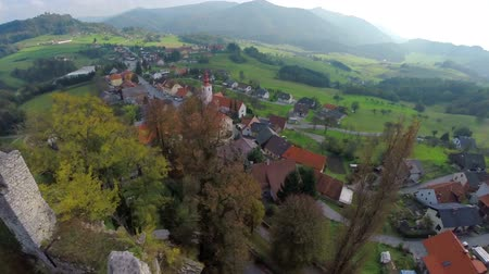 к северу : Medieval castle with a beautiful view. Helicopter camera flying across the midlives  castle in the middle of the beautiful landscape on sunny summer day.