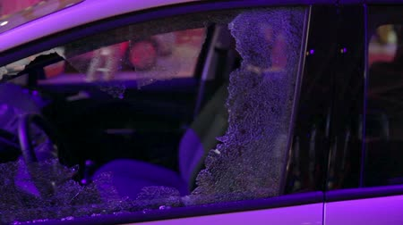 кража : Car with broken window. Shot of damaged window pane cracked by theft at night