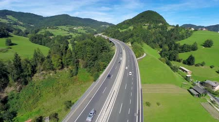 otoyol : Highway road in a nature. Aerial shoot of a highway road with traffic cars and trucks in a nature full of small hills and valley
