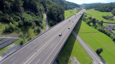 otoyol : Aerial shoot of a highway and motorway. Aerial shoot of a highway and motorway road full of cars and trucks for transportation Stok Video