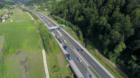 otoyol : Highway from the sky. Aerial shoot of a highway in a valley near a small village