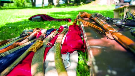 dýka : Vintage swards put on display. On this low motion close up RAW footage are vintage swards who are put on the display on the green grass on sunny day.