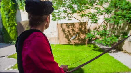 kuşatma : Turkish princess training shooting with bow. On this close-up slow motion footage of a Turkish princess on the training to shoot with wooden bow.