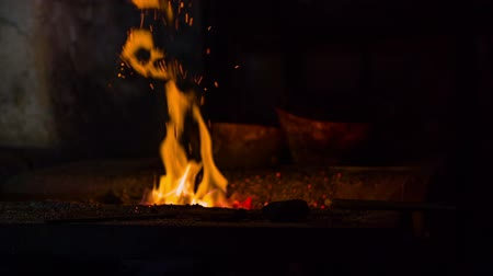 alevler : Fire in the blacksmith shop in the early modern period. Close-up slow motion footages of a small working flame in the vintage blacksmith shop from midlives times.