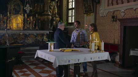 church utensils : Middle-aged couple comes to the altar. Zooming-in footages of a middle-age couple coming to the alter in the beautiful midlives Catholic Church. Stock Footage