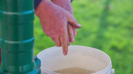 drží se za ruce : Washing dirty hands in a plastic container full of water. Slow motion close up footage of a man who is cleaning  his hands in the basket full of water on the countryside. Dostupné videozáznamy