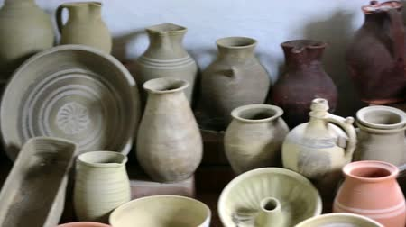 kamenina : A room full of old clay pots. On this footage camera flays across the room full of vintage pots lying on the ground in the historic village house.