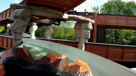 rolete : GARDA, ITALY - MAY 05, 2012: Shots of river attraction with trunks as boats in amusement park