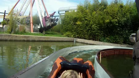 travel theme : GARDA, ITALY - MAY 05, 2012: Shots of river attraction with trunks as boats in amusement park