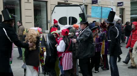 all ages : DOMZALE, SLOVENIA - FEB, 2012: Carnival of different joyful and playful masquerade costumes dressed people of all ages walking down the street past audience in Slovenia Stock Footage